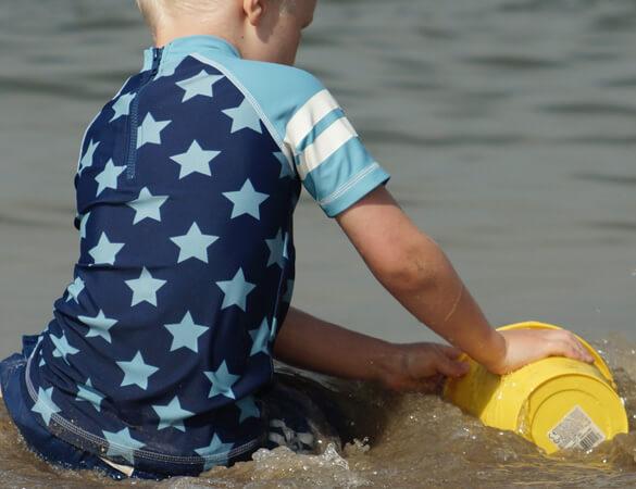 Partners-in-Paediatrics-boy-playing-beach-closeup