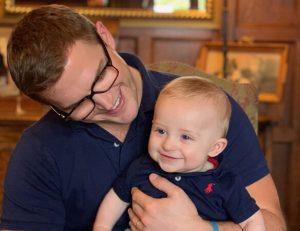 Partners-in-Paediatrics-man-baby-smiling